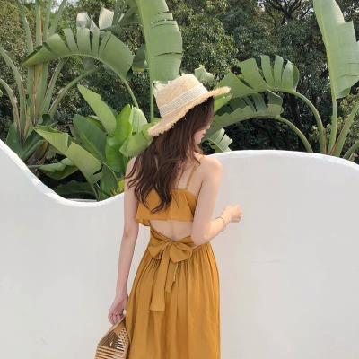 露腰姜黄色连衣裙仙女小心机中长款露背度假风沙滩吊带裙
